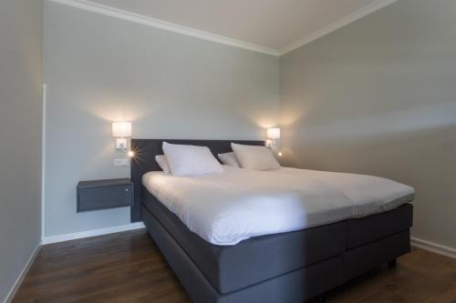 Een bed of bedden in een kamer bij B&B de Lijsterhof - Seayou Zeeland