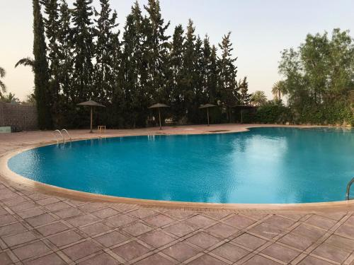 The swimming pool at or near Annakil Appart