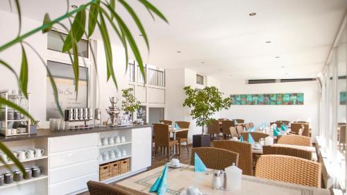 Ein Restaurant oder anderes Speiselokal in der Unterkunft Hotel Amerika