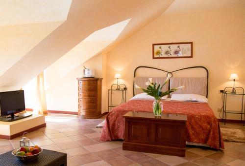 Ein Bett oder Betten in einem Zimmer der Unterkunft Hotel Aquadolce