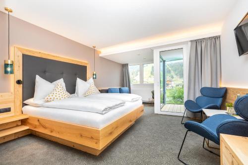 Ein Bett oder Betten in einem Zimmer der Unterkunft Hotel Forellenhof