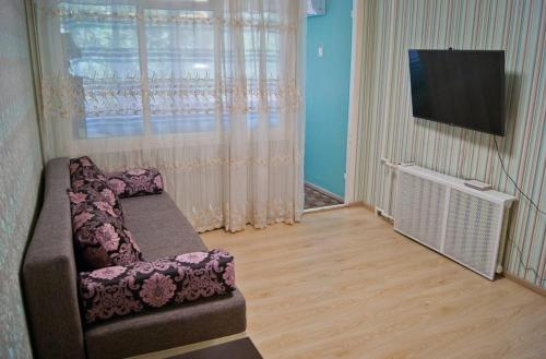 Телевизор и/или развлекательный центр в Apartament on Podgornaya 5