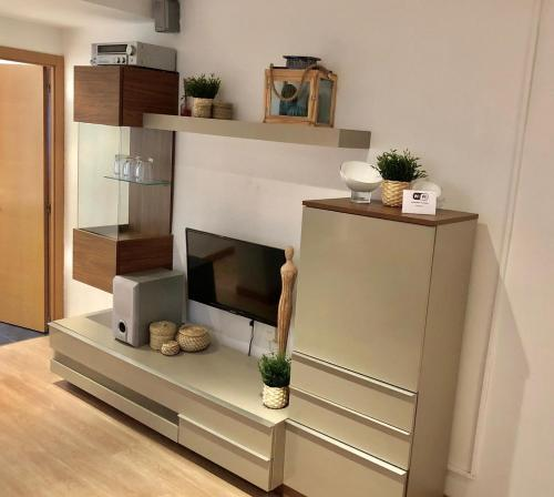 A television and/or entertainment center at Apartamento Ana Isabel Herrero
