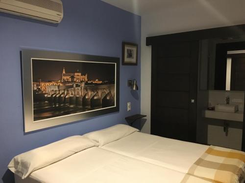 Cama o camas de una habitación en Hospederia Alma Andalusi