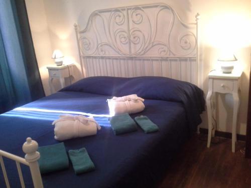 Letto o letti in una camera di Roman Enchantment