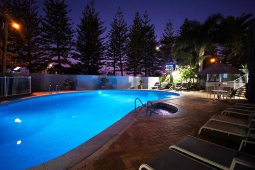 The swimming pool at or near Cashelmara Beachfront Apartments