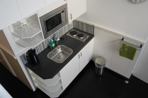 Küche/Küchenzeile in der Unterkunft City Hotel Vlissingen
