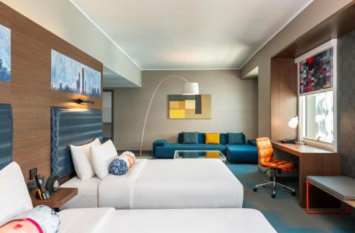 A bed or beds in a room at Aloft Al Ain