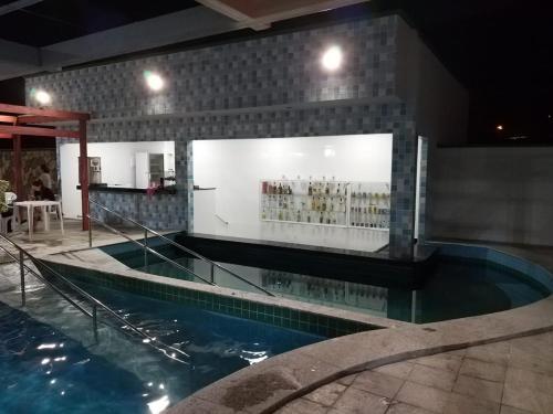 The swimming pool at or near Apartamento Aquarius Residence