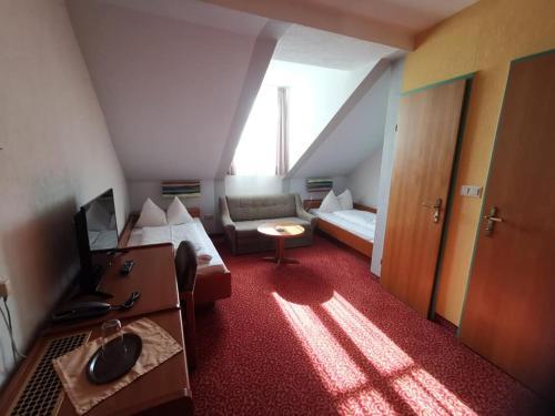 Ein Sitzbereich in der Unterkunft Stadthotel Hauser Eck
