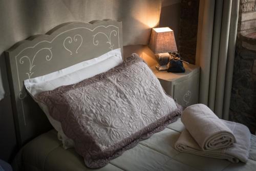 Letto o letti in una camera di B&B La Ca Vecia