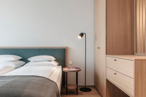 Ein Bett oder Betten in einem Zimmer der Unterkunft VillaVerde Aparthotel