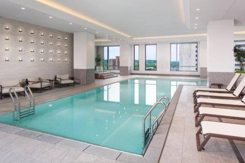 The swimming pool at or near Hilton Rochester Mayo Clinic Area