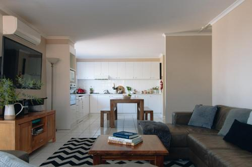 A kitchen or kitchenette at Torquay Retreats - Anderson