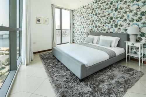 A bed or beds in a room at Frank Porter - Marsa Plaza