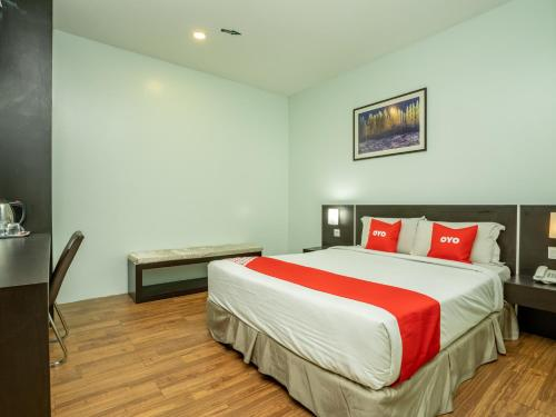 A bed or beds in a room at One Garden Hotel @ Senawang