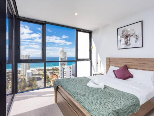 A bed or beds in a room at Premium Ocean View Apartment by Serain Residences