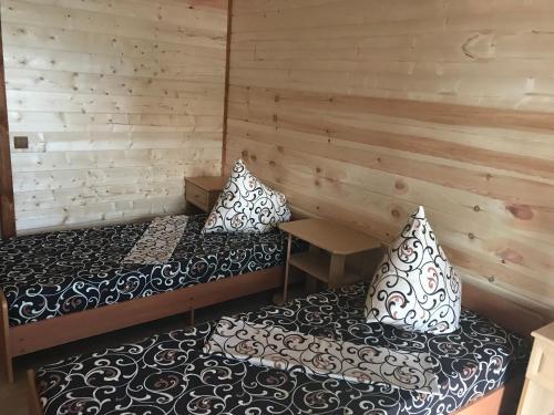 A bed or beds in a room at Гостевой дом на Восточной