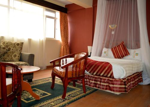 A bed or beds in a room at Hillcourt Resort and Spa