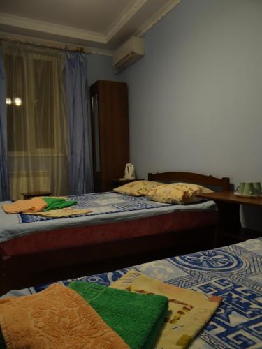 Кровать или кровати в номере Прованс Гостевой Дом