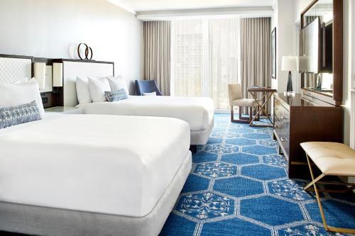 A bed or beds in a room at Fairmont El San Juan Hotel