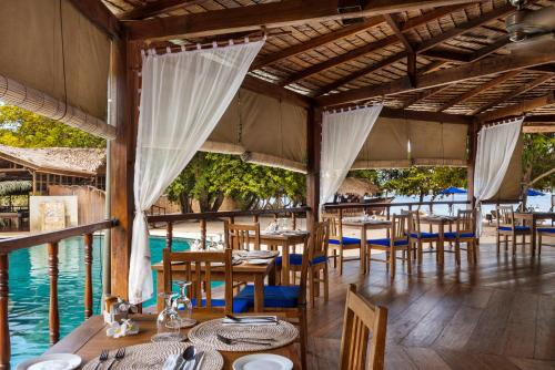 A restaurant or other place to eat at Siladen Resort & Spa