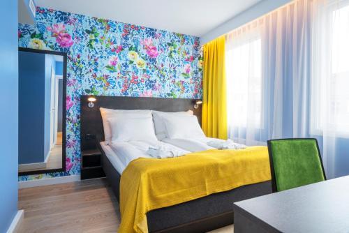 En eller flere senger på et rom på Thon Hotel Moldefjord