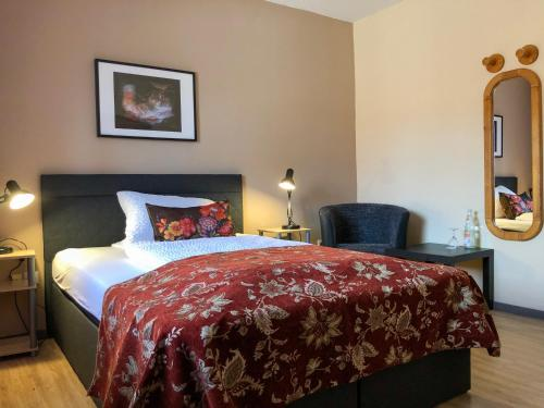 Ein Bett oder Betten in einem Zimmer der Unterkunft Hotel Restaurant Denis