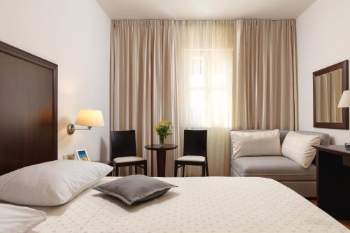 Postel nebo postele na pokoji v ubytování Hotel Croatia