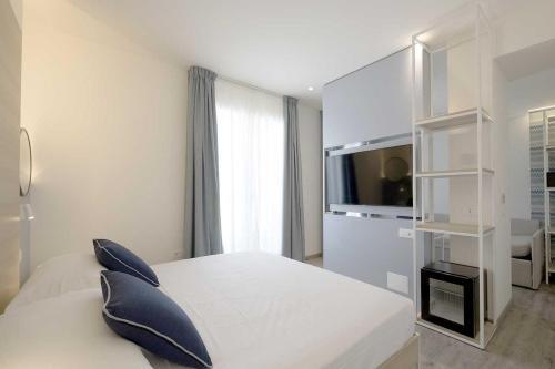 Letto o letti in una camera di Hotel Baia