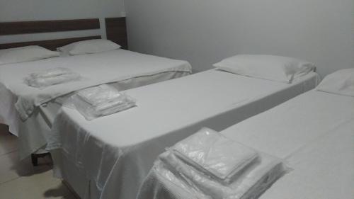 Cama ou camas em um quarto em Golden Hotel