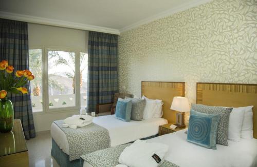 מיטה או מיטות בחדר ב-Taba Sands Hotel & Casino - Adult Only