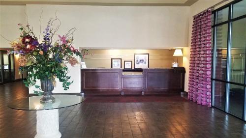The lobby or reception area at Ramada by Wyndham Orlando Florida Mall