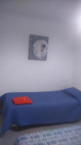 Una cama o camas en una habitación de Esquel te espera