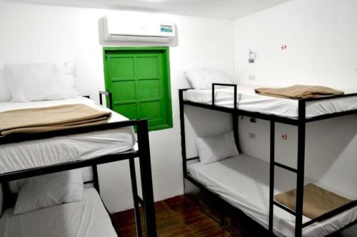 A bunk bed or bunk beds in a room at Dream Home Hostel