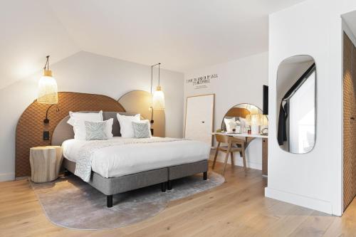 Cama o camas de una habitación en Black Bass Hotel
