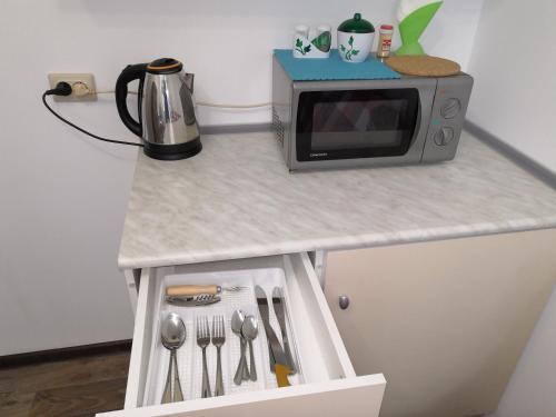 A kitchen or kitchenette at Мини-Студия в Крюково