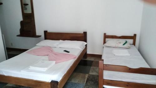 Cama ou camas em um quarto em Pousada La Lampara