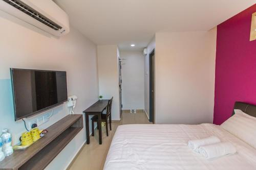 A television and/or entertainment center at U Plus Budget Hotel