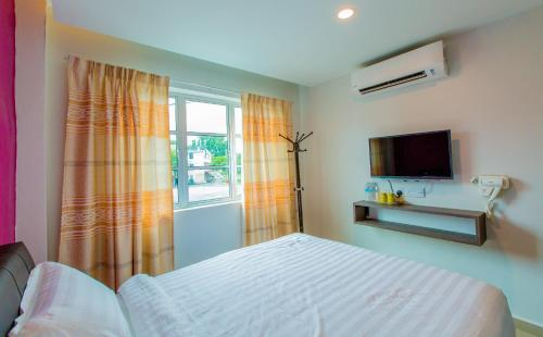 A bed or beds in a room at U Plus Budget Hotel