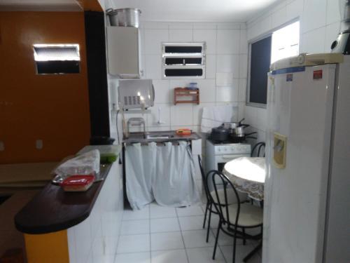 A cozinha ou cozinha compacta de Pousada Temporada Maceió