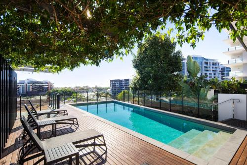 The swimming pool at or near Alcyone Hotel Residences