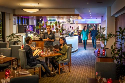 A restaurant or other place to eat at Copthorne Hotel Auckland City