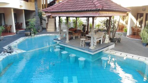 The swimming pool at or near The Flora Kuta Bali