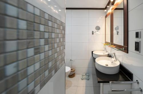 Ванная комната в Auberge Chez Plume