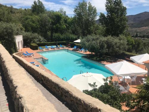 The swimming pool at or near Villa Turística de Laujar de Andarax