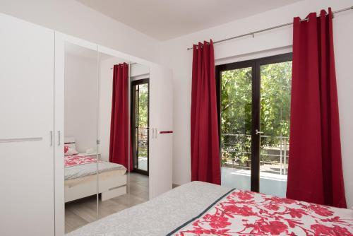 Postel nebo postele na pokoji v ubytování Apartmani Jadranka