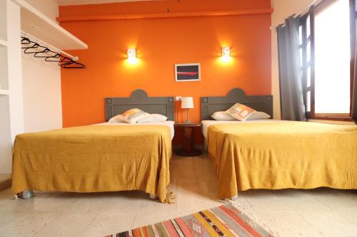 A bed or beds in a room at Wabi Hostel