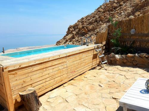 The swimming pool at or near The Cliff Cabin at Metzoke Dragot