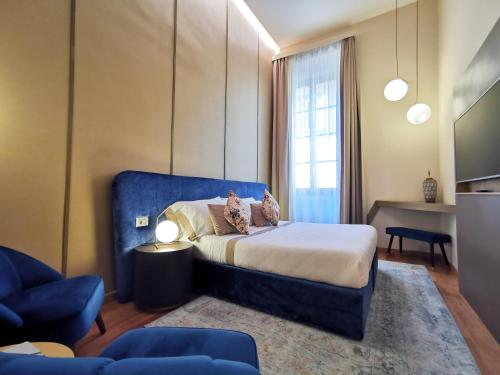 A bed or beds in a room at Renascentia in Florence